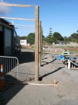 Poles upright and concreted in position