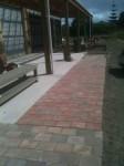 Paving extended along verandah